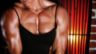 Female bodybuilder Jennifer Scarpetta felxing her amazing thick pecs
