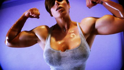 Goddess Rapture flexing her thick biceps.