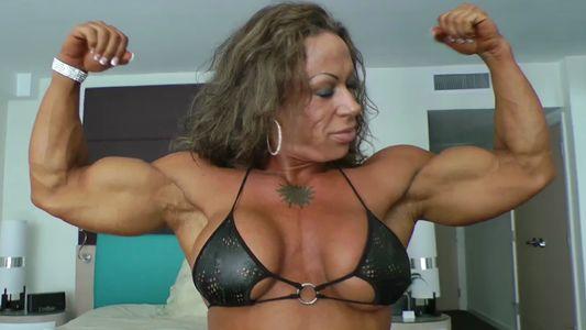 Jennifer Kennedy flaunting huge muscles
