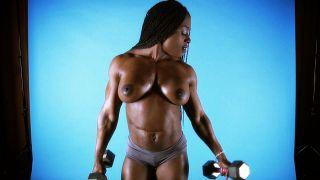 Muscular ebony muscle girl Ashley Starr.