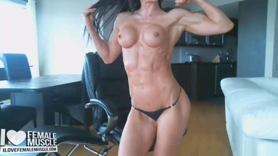 Muscle Girl flaunting her perky tits and muscle