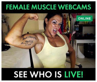 Suzy Kellner flexing bicep on her webcam