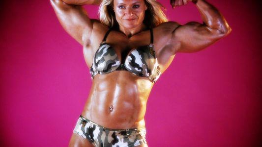 Huge female bodybuilder Brigita Brezovac flexing her bicep.