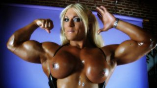 Lisa Cross flexing her huge biceps topless