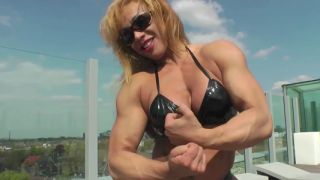 Rita Sargo flexing huge bicep muscle