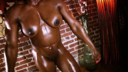 oiled up girl with muscle