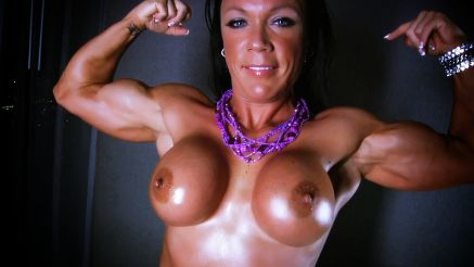 female muscle topless and flexing biceps