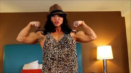 female bodybuilder Brandi Mae flexing hard biceps