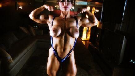 female bodybuilder flexing topless