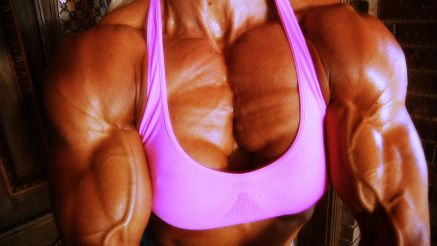 bodybuilder in contest shape pec flex