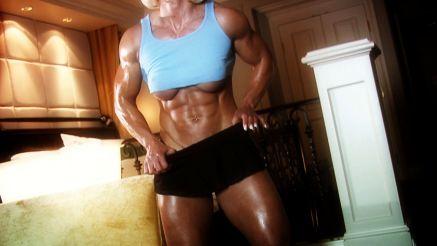 massive muscular female bodybuilder flexing
