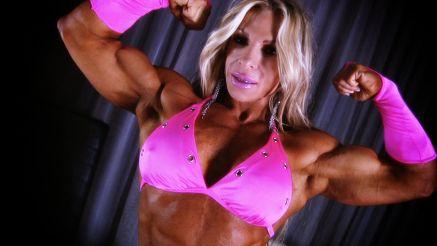 female bodybuilder Debi Laszewski flexing big biceps