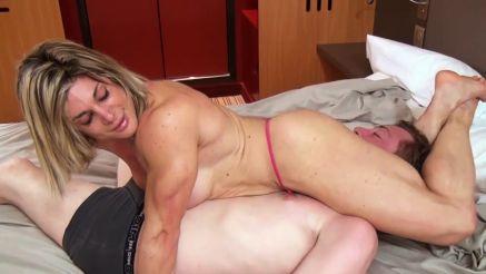 female bodybuilder scissoring a guy wrestling