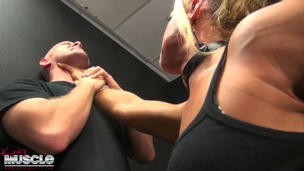 muscular woman lifts a guy up
