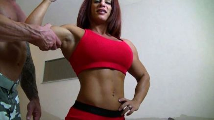 muscular woman showing off her muscles