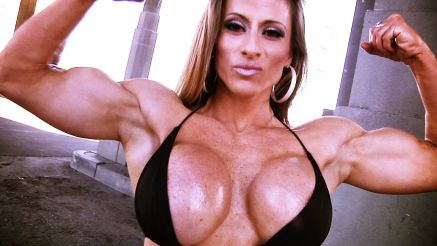 muscle girl with big tits flexing biceps