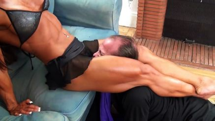 bodybuilder squeezing guy with muscular legs
