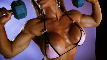 fitness model with huge tits working out
