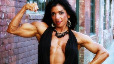 muscle MILF Marina Lopez flexing her bicep