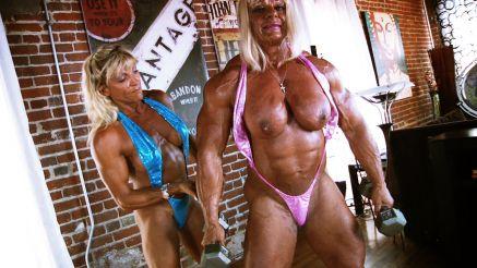 female bodybuilder Maryse Manios topless bicep curls