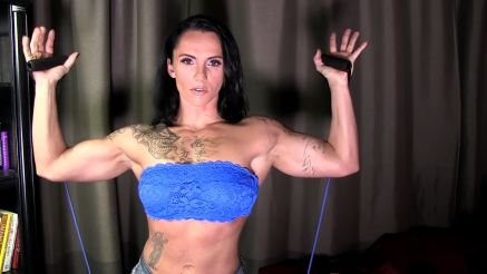 girl with tattoos and bicep working out