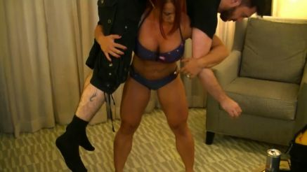 muscular woman lift and carry a guy