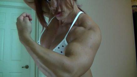 female bodybuilder Mz Devious flexing her huge arms