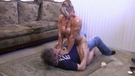 naked female bodybuilder MILF on top of a guy