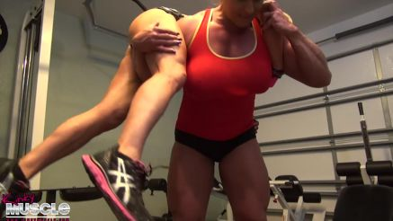 female bodybuilders working out showing off strength