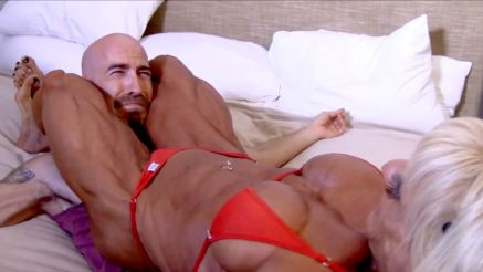 female bodybuilder crushing a guy with her legs