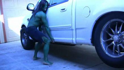 massive she hulk lifting up a truck