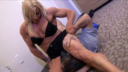 female bodybuilder sitting on a guys face
