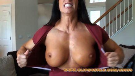 massive female bodybuilder tearing off her shirt