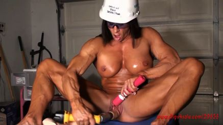 xxx female bodybuilder playing with power tools